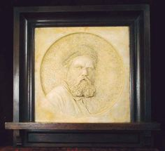 "Martin Brothers Pottery - Robert Wallace Martin (1843-1923) - Self Portrait Plaque. Glazed Terracotta in Wood Frame. Southall, Middlesex, England. Circa 1883. 13"" x 13""."