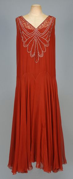 CHIFFON EVENING DRESS with RHINESTONES and LACE, c. 1930. Sleeveless russet silk having V-neck and back inset with lace and prong set rhinestones in a scalloped pattern, shaped waistline, full skirt and matching silk under-dress. B-40, L-54. Excellent.