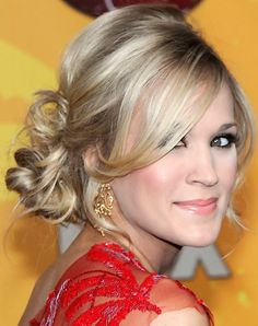 Carrie Underwood Long Hairstyle: Messy Bun and long bangs