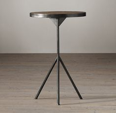 Nice small cool table if needed in Craig's office or somewhere near a chair?  Possibly library: Elm & Iron Tripod Side Table