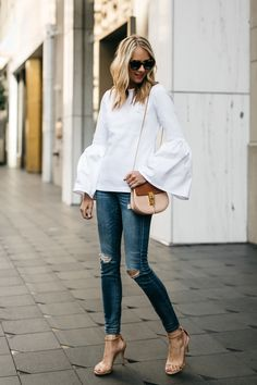 White top with wide sleeve and nude heels