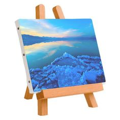 "This blue landscape photograph by Rick Nye is the perfect addition to your home décor. The canvas uses a printing method called a ""gicle"" process, which uses fade-resistant archival pigment-based inks directed to the canvas surface, resulting in a very detailed print that will last a lifetime. Get the canvas and add a touch of blue to your walls. The canvas is 9"" x 14"" on loose print.'"