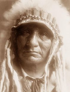 """""""Red Hawk"""" Cetanluta (1854 - 1928) was an Oglala Sioux chieftan and a member of Red Dog Oyukhpes. He went on his first war party at the age of eleven. He eventually participated in twenty battles, including the battle against Custer at the Little Bighorn in 1876.  Photograph 1907"""