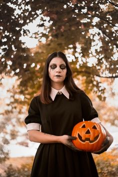 Woman Wearing Black and White Collared Dress With Halloween Makeup Holding Jack-o'-lantern Near Green Leaf Tree · Free Stock Photo Jack O, Product Offering, Collar Dress, Wearing Black, Halloween Makeup, Free Stock Photos, New Product, Lanterns, Collars