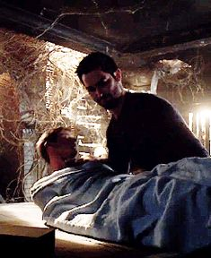"""Damon lays Ren down gently on the table. """"Is he going to be okay? """" I ask, biting my thumb nail in worry. Damon stares down at him for a long moment, then turns his bright blue eyes on me. """"I don't know."""""""