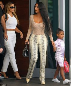 The Keeping Up With The Kardashian star's outfit did little to hide her knock-out curves, as the star donned tight snakeskin trousers and a matching top which scooped low to reveal her bust. Kardashian Photos, Kardashian Style, Kardashian Jenner, Kim Kardashian Blazer, Robert Kardashian, Mode Kylie Jenner, Kendall Jenner Outfits, Yeezy Fashion, Women's Fashion