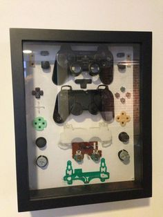 Cool idea for decorating a game room with broken controllers. Love this idea.