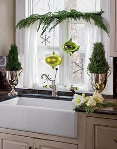 Tiny trees in big shiny urns - love #Christmas - like the ferns. The other stuff seems overkill