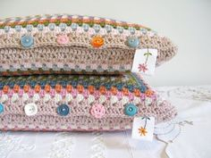 Granny square pillows...w/ buttons, can remove the pillow for washing.