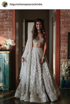 Glimmering lehenga adds bling to your reception look. Get this customized hand embroidered outfit from nivetas design studio Contact us on… Indian Wedding Wear, Indian Bridal Outfits, Indian Designer Outfits, Indian Weddings, Indian Wedding Bridesmaids, Hindu Weddings, Peach Weddings, Indian Party, Dress Indian Style