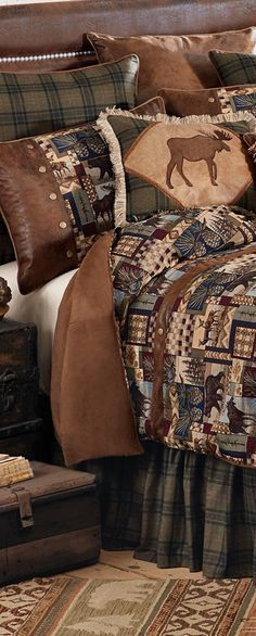 Woodland Cabin Bedding:Patchwork wildlife scenes in wine, navy, forest green and browns are woven in a cotton/poly tapestry complemented by brown faux suede, olive and black plaid and antique brass rivets to create this inviting lodge bedding.