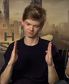 "shoot-the-smiley: "" ""Thomas Sangster + running hands (x) "" """