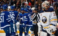Andreas Johnsson #18 of the Toronto Maple Leafs is congratulated by teammates Tomas Plekanec #19, Roman Polak #46, and Jake Gardiner #51 after scoring on Chad Johnson #31 of the Buffalo Sabres during the first period at the Air Canada Centre on April 2, 2018 in Toronto, Ontario, Canada. (Photo by Mark Blinch/NHLI via Getty Images)