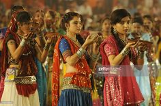 Girls perform aarti on the first day of Navratri festival near Madan Mahal garden on September 25, 2014 in Indore, India. Hindu festival of Navratri is observed twice a year, once in the beginning of summer and again at the onset of winter. Navratri means nine nights during which nine forms of Goddess/ Shakti/Devi are worshiped.