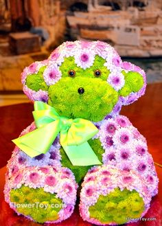 This Monkey arrangement is made of fresh flowers and looks like your favorite toy.