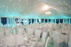 Aqua lighting effects make this all-white tent #reception modern & futuristic. Thanks, Bridal Guide Magazine for sharing!