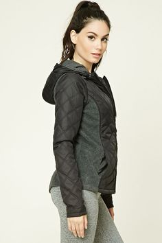 A woven jacket featuring a quilted design, fleece panels, drawstring hood, zip-up front, two front pockets, and long sleeves with thumb inserts.