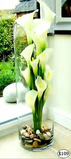 White Calla Lily REAL TOUCH Flower Arrangements LOOK and FEEL REAL and are permanently set hard in a clear ARTIFICIAL WATER, guaranteed to look fresh forever. Handmade, modern Flower Arrangements that are ideal for Allergy Sufferers. Perfect for Home Decor, Weddings, Offices and Special Occasions. Flower Arrangements come exactly as pictured, with flowers, vase and simulated water. Easy to clean with baby wipes. Pick-up welcome or cheap courier delivery available Australia wide. by bette
