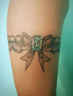 Side of my garter, with a turquoise gemstone. @Old Bastards Tattoo Shop