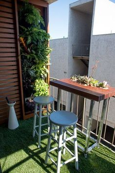 This Simple Balcony Design Includes A Vertical Garden Wall And A Bar Table  With Two Bar Stools.