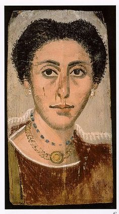 On all the Fayum portraits, I am seeing something that my research is backing up; women, even wealthy women, were expected to show restraints when showcasing their wealth. You never see them wearing more than two necklaces. They are almost uniformly gold, and people seem to have favored green stones, red stones, or glass. Pearls are commonly featured on the earrings.