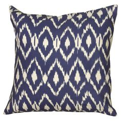 Add a pop of pattern to your sofa or loveseat with this eye-catching cotton pillow, showcasing an ikat diamond motif.   Product: Pill...