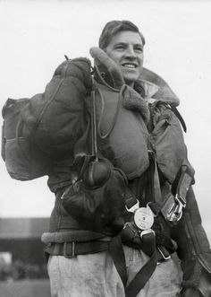 A Royal Air Force pilot shortly after landing following a raid on the continental coast a few weeks after the onset of WW2 in Sept 1939. Note the extremely bulky kit that includes life vest and shearling leather jacket; the two together must be at least six kilos. And there's the parachute and the heavy boots. Generally, comfort was an unknown word among pilots of the time.