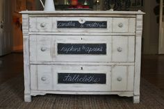 Applying chalk board paint to label drawers.