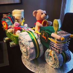 John Deere tractor diaper cake with attached  wagon of goodies.