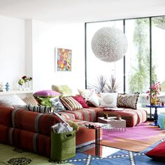 Ok, where to I begin loving this...hmmm. Maybe the layered rugs, the giant orb lamp, the massive windows or the serious lounging area for relaxation and socializing and or the perfect balance of space and comfort. ah