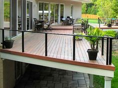 Deck Railing with Glass Panels Visit more Deck Railing Ideas http://awoodrailing.com/2014/11/16/100s-of-deck-railing-ideas-designs/