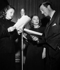 Birthday gal Isabel Jewell joins Barbara Stanwyck and Robert Taylor on a radio program