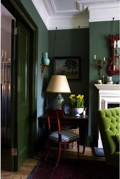 Love the green walls and lighter green chair