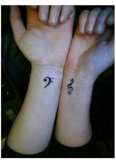 Treble and Bass Clef Wrist Tattoos