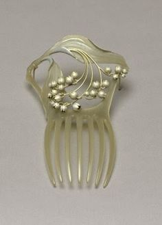 Circa 1900 René Lalique Art Nouveau Hair Comb. Carved Mother of Pearl and Silver. France.
