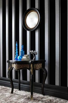The high-quality flock wallpaper Nabo with its stripey décor features a shimmering silver background adorned with delicate wavy lines. The velvety black stripes are extremely tactile. #interiorideas#wallcovering #wallcovering#homeinspiration