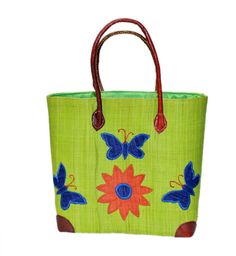 Mamy – Butterfly  Raffia Basket, Tote Bag in 3 different sizes is  one of our best seller.  This basket is a great basket for shopping,  beach bag, and storage.  Our beautiful basket with a leather handles is lined with cotton material and also has a draw string.  Our tote is made of raffia and straw by the  artisan women from Madagascar, Africa.  Dimensions: 14W x 10.5H x 6.5D 16W x 13H x 8D 18W x 15H x 9.5D
