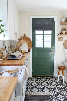green with black and white and wood. Loving the statement tiles on these floors!