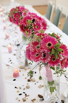 Gerber Daisy Wedding Bouquets - add bridesmaids bouquets to pretty vases or glasses for reception table centerpieces.