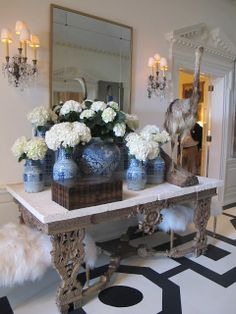 Great table, fluffy benches, blue & white pottery  |  Melanie Turner via Habitually Chic®