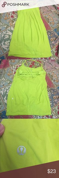 Lululemon Strappy Back Workout Top Size 4 In great condition! Has a built in bra. Has all these cool straps in the back. In a size 4 lululemon athletica Tops Tank Tops