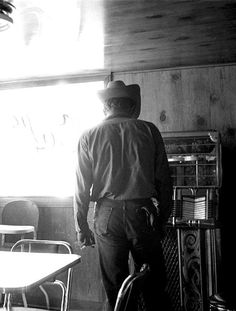James Dean looking at a jukebox in a Café, Texas, 1955. photographed by Richard C. Miller