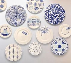 blue and white plates on the kitchen walls - always
