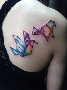 The water colored Origami Birds. Two birds with multi colors seemed to be flying in this tattoo design. The tattoo is surely mind catching with some unique and decent touch.