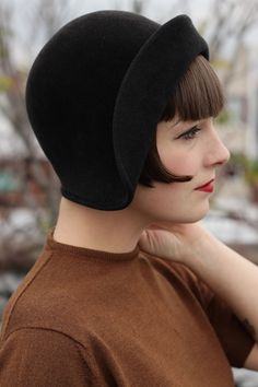 I love smaller hats like those of the 1940s.  They are chic and understated.