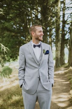 Light gray tuxedo, navy blue bowtie, groom style // Loveridge Photography