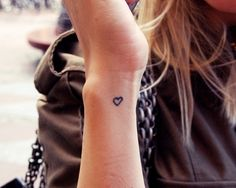Wrist tiny heart tattoo