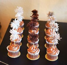 Use metallic yarn pom-poms as cupcake toppers. | 51 DIY Ways To Throw The Best New Year's Party Ever