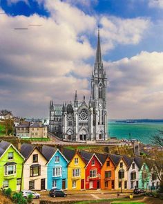 Loving this sight of colorful houses in Cobh, Ireland 🇮🇪 By: Sergiu Cozorici — in Cobh, Ireland. Montmartre Paris, Emerald Isle, Europe Destinations, Beautiful Castles, Beautiful Places, London England, Vacation Ideas, Hotel Am Strand, Ireland Travel Guide