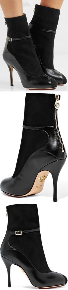Taking one of this season's chicest shoe trends to new heights, Charlotte Olympia's 'Incognito' boots are designed to look like a pair of leather pumps worn with socks, and are paneled with suede to create the effect. This pair has a stiletto heel and decorative buckle-fastening ankle strap. #socksandheels